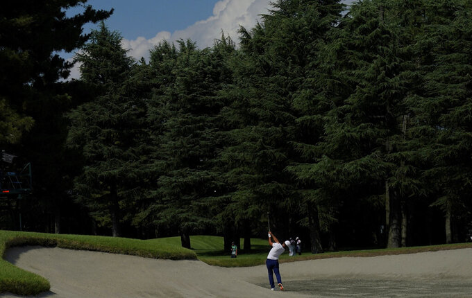 Xander Shauffele of United States plays a shot from a cross bunker on the 14th hole during the third round of the men's golf event at the 2020 Summer Olympics on Saturday, July 31, 2021, in Kawagoe, Japan. (AP Photo/Matt York)
