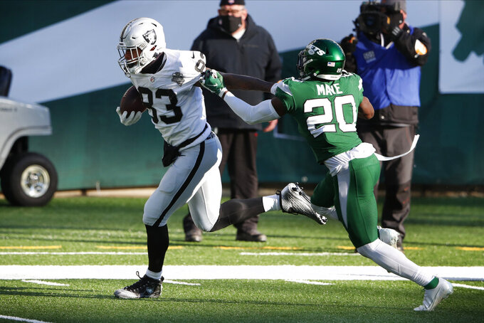 Las Vegas Raiders' Darren Waller, left gets past New York Jets' Marcus Maye for a touchdown during the first half an NFL football game, Sunday, Dec. 6, 2020, in East Rutherford, N.J. (AP Photo/Noah K. Murray)
