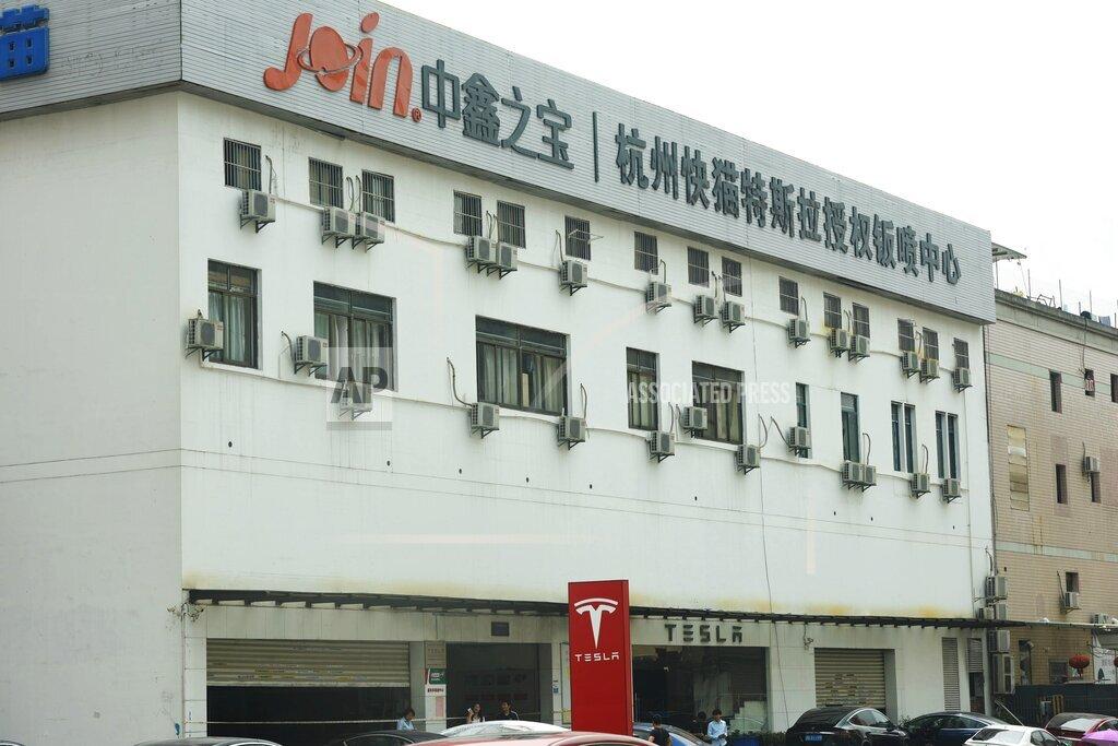 CHINA CHINESE ZHEJIANG HAGNZHOU TESLA REPAIR SHOP FIRE IGNITION