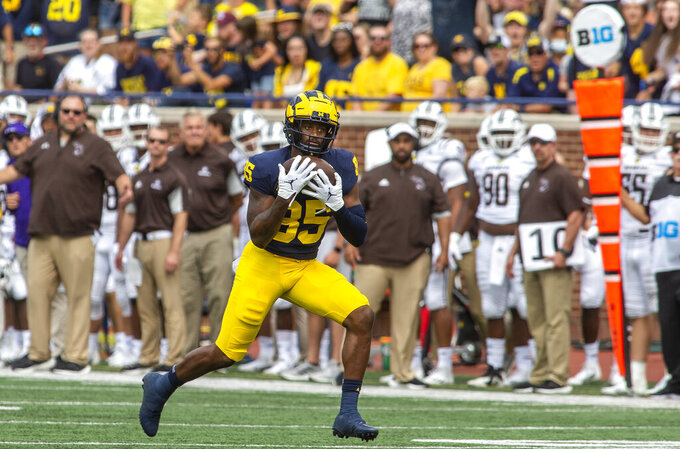 Michigan wide receiver Daylen Baldwin (85) catches a 69-yard pass for a touchdown in the fourth quarter of an NCAA college football game against Western Michigan in Ann Arbor, Mich., Saturday, Sept. 4, 2021. Michigan won 47-14. (AP Photo/Tony Ding)