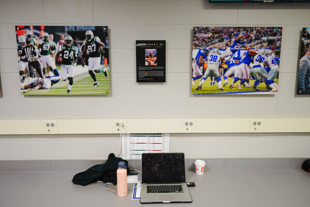 A memorial for photographer Anthony Causi is displayed in the photo workroom at MetLife Stadium after an NFL football game between the New York Jets and the San Francisco 49ers Sunday, Sept. 20, 2020, in East Rutherford, N.J. The Jets and the New York Giants renamed the photo workroom at the stadium in honor of Causi, a New York Post photographer who died at 48 in April from the new coronavirus. (AP Photo/Frank Franklin II)