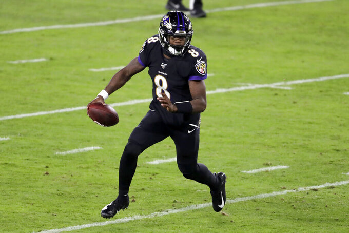 Baltimore Ravens quarterback Lamar Jackson scrambles against the New York Jets during the first half of an NFL football game, Thursday, Dec. 12, 2019, in Baltimore. On the run, Jackson broke the single season record for most rush yards by a quarterback in NFL history. (AP Photo/Julio Cortez)