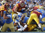 UCLA running back Joshua Kelley (27) scores a rushing touchdown against Southern California during the first half of an NCAA college football game Saturday, Nov. 17, 2018, in Pasadena, Calif. (AP Photo/Marcio Jose Sanchez)