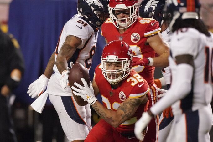 Kansas City Chiefs strong safety Tyrann Mathieu (32) intercepts a Denver Broncos quarterback Drew Lock pass in the first half of an NFL football game in Kansas City, Mo., Sunday, Dec. 6, 2020. (AP Photo/Charlie Riedel)