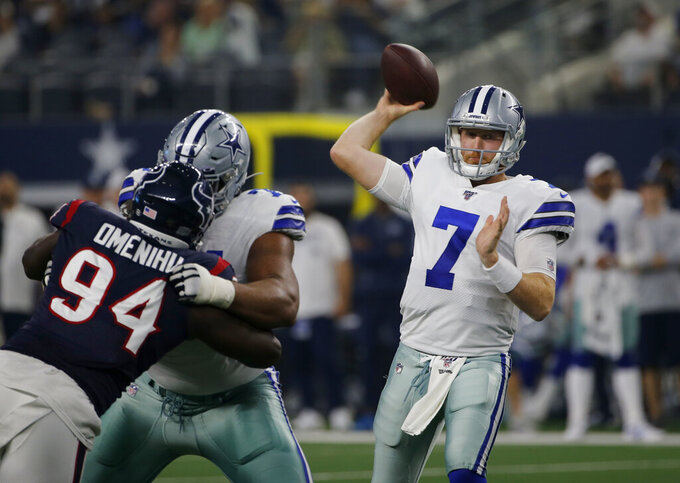 Houston Texans defensive end Charles Omenihu (94) rushes as Dallas Cowboys quarterback Cooper Rush (7) throws a pass in the first half of a preseason NFL football game in Arlington, Texas, Saturday, Aug. 24, 2019. (AP Photo/Michael Ainsworth)
