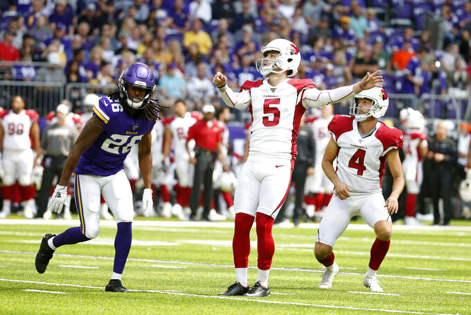 Arizona Cardinals place kicker Zane Gonzalez (5) kicks a 32-yard field goal in front of Minnesota Vikings cornerback Trae Waynes, left, during the first half of an NFL preseason football game, Saturday, Aug. 24, 2019, in Minneapolis. (AP Photo/Bruce Kluckhohn)