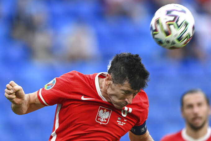 Poland's Robert Lewandowski heads the ball during the Euro 2020 soccer championship group D match between Sweden and Poland, at the St. Petersburg stadium in St. Petersburg, Russia, Wednesday, June 23, 2021. (AP Photo/Kirill Kudryavtsev, Pool)