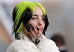 FILE - In this Feb. 9, 2020, file photo, singer Billie Eilish arrives at the Oscars in Los Angeles. Billie Eilish scored 12, 2020 Billboard Music Awards nominations, dick clark productions and NBC announced Tuesday, Sept. 22, 2020.  (AP Photo/John Locher, File)