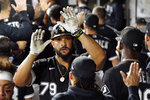 Chicago White Sox's Jose Abreu (79) is greeted in the dugout after hitting a three-run home run against the Boston Red Sox during the third inning of a baseball game, Friday, Sept. 10, 2021, in Chicago. (AP Photo/David Banks)