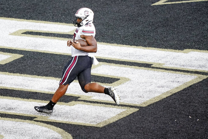 South Carolina running back Kevin Harris scores a touchdown on a 25-yard run against Vanderbilt in the second half of an NCAA college football game Saturday, Oct. 10, 2020, in Nashville, Tenn. (AP Photo/Mark Humphrey)
