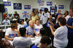 Former Vice President and Democratic presidential candidate Joe Biden, center, poses for a photo during a campaign phone bank event at an electrical workers union hall Saturday, July 20, 2019, in Las Vegas. (AP Photo/John Locher)