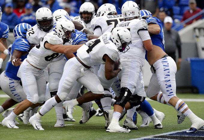 Central Florida running back Taj McGowan (4) scores a touchdown on a 2-yard run against Memphis during the first half of an NCAA college football game Saturday, Oct. 13, 2018, in Memphis, Tenn. (AP Photo/Mark Zaleski)