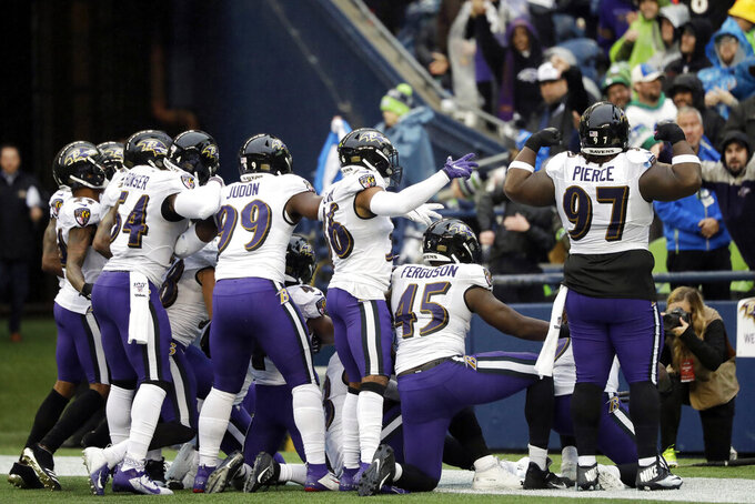 Back from bye, healthier Ravens await showdown with Patriots
