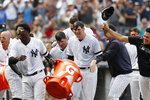 New York Yankees teammates celebrate with the Mike Ford, third from left, after dousing him with a sports drink Sunday, Sept. 1, 2019, in a baseball game in New York. Ford hit a ninth-inning, pinch-hit, walk-off home run in the Yankees' 5-4 win over the Oakland Athletics. (AP Photo/Kathy Willens)