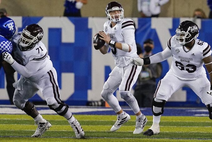 Mississippi State quarterback K.J. Costello (3) prepares to throw a pass during the second half of the team's NCAA college football game against Kentucky, Saturday, Oct. 10, 2020, in Lexington, Ky. (AP Photo/Bryan Woolston)
