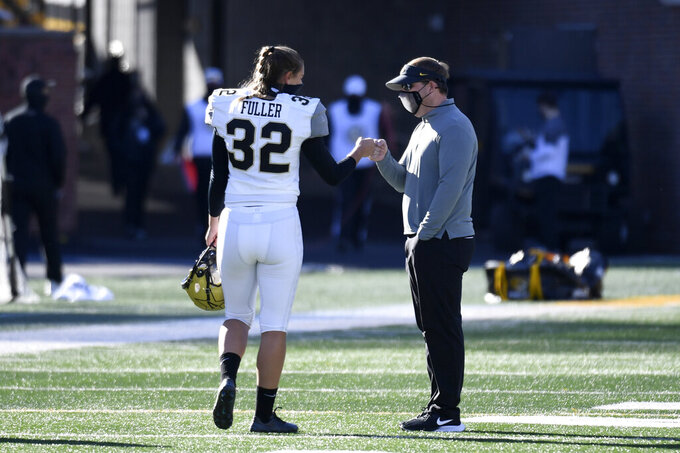 Vanderbilt place kicker Sarah Fuller (32) gets a fist bump from Missouri head coach Eliah Drinkwitz after warming up before the start of an NCAA college football game Saturday, Nov. 28, 2020, in Columbia, Mo. (AP Photo/L.G. Patterson)