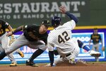 Pittsburgh Pirates' Kevin Newman tags out Milwaukee Brewers' Avisail Garcia as he tries to steal second during the sixth inning of a baseball game Friday, April 16, 2021, in Milwaukee. (AP Photo/Morry Gash)