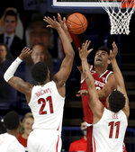 Arizona forward Jordan Brown (21), left, and forward Ira Lee (11) force Stanford forward Oscar da Silva (13) into shooting off the backboard in the first half of an NCAA college basketball game in Tucson, Ariz., Jan. 28, 2021. (Kelly Presnell/Arizona Daily Star via AP)