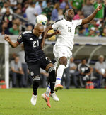 Mexico defender Luis Rodriguez (21) and Costa Rica forward Joel Campbell (12) go for a head ball during the first half of a CONCACAF Gold Cup soccer quarterfinal Saturday, June 29, 2019, in Houston. (AP Photo/Michael Wyke)