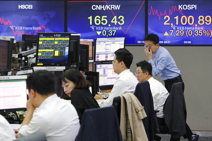 Currency traders watch monitors at the foreign exchange dealing room of the KEB Hana Bank headquarters in Seoul, South Korea, Tuesday, Oct. 29, 2019. Shares were mixed in Asia and Chinese benchmarks fell Tuesday after the S&P 500 index closed at an all-time high. (AP Photo/Ahn Young-joon)