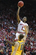 Indiana guard Aljami Durham (1) shoots over Wichita State guard Erik Stevenson (10) in the second half of an NCAA college basketball game in the third round of the NIT tournament, in Bloomington, Ind., Tuesday, March 26, 2019. Wichita State won 73-63. (AP Photo/AJ Mast)