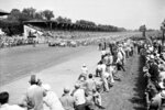 FILE - In this Tuesday, May 30, 1950, file photo, thirty-three racers hit the starting line to begin the Memorial Day 500-mile race at the Indianapolis Motor Speedway Track in Indianapolis, Ind. Indianapolis Motor Speedway and the IndyCar Series were sold to Penske Entertainment Corp. in a stunning move Monday, Nov. 4, 2019, that relinquishes control of the iconic speedway from the Hulman family after 74 years. (AP Photo/File)