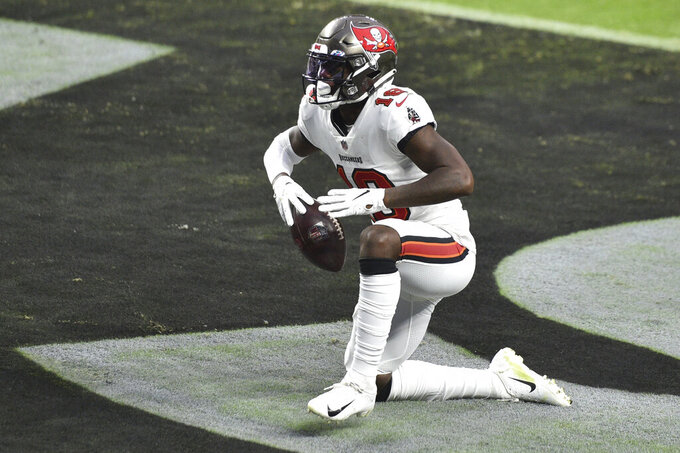 Tampa Bay Buccaneers wide receiver Tyler Johnson (18) celebrates after scoring a touchdown against the Las Vegas Raiders during the second half of an NFL football game, Sunday, Oct. 25, 2020, in Las Vegas. (AP Photo/David Becker)