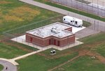 FILE - In this June 11, 2001 file photo, an aerial view of the execution facility at the United States Penitentiary in Terre Haute, Ind., is shown. After the latest 17-year hiatus, the Trump administration wants to restart federal executions this month at the Terre Haute, prison. Four men are slated to die. All are accused of murdering children in cases out of Arkansas, Kansas Iowa and Missouri. (AP Photo/Michael Conroy File)