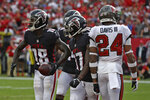 Atlanta Falcons wide receiver Calvin Ridley (18) celebrates his touchdown with teammates against the Tampa Bay Buccaneers during the second half of an NFL football game Sunday, Sept. 19, 2021, in Tampa, Fla. (AP Photo/Jason Behnken)