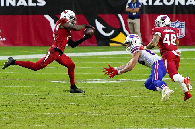 Arizona Cardinals cornerback Patrick Peterson (21) intercepts a pass intended for Buffalo Bills tight end Dawson Knox, right, during the second half of an NFL football game, Sunday, Nov. 15, 2020, in Glendale, Ariz. (AP Photo/Rick Scuteri)