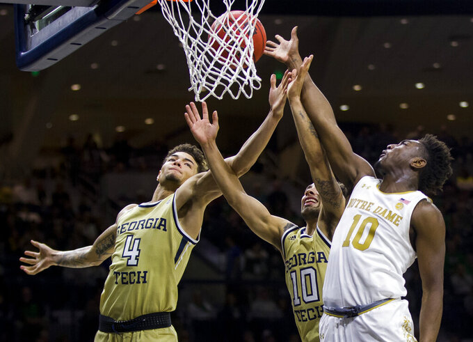 Georgia Tech's Jordan Usher (4) and Jose Alvarado (10) compete for a rebound with Notre Dame's Temple 'T.J.' Gibbs (10) during the second half of an NCAA college basketball game Saturday, Feb. 1, 2020, in South Bend, Ind. Notre Dame won 72-80. (AP Photo/Robert Franklin)