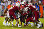 Florida quarterback Emory Jones, center, is stopped by the Florida Atlantic defense, including linebacker Eddie Williams (3), linebacker Chris Jones (49), cornerback Jayden Williams and defensive tackle Marcel Southall, on a fourth-down play during the first half of an NCAA college football game Saturday, Sept. 4, 2021, in Gainesville, Fla. (AP Photo/John Raoux)