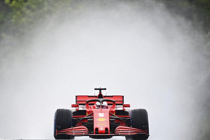 Ferrari driver Sebastian Vettel of Germany steers his car during the second practice session for the Hungarian Formula One Grand Prix at the Hungaroring racetrack in Mogyorod, Hungary, Friday, July 17, 2020. The Hungarian F1 Grand Prix will be held on Sunday. (Joe Klamar/Pool via AP)