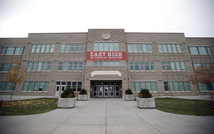 This Oct. 28, 2019 photo, shows the facade of East High School in Salt Lake City. The iconic filming location of Disney's High School Musical still stands as a typical American high school, with a not-so-typical draw from tourists. (Kristin Murphy/The Deseret News via AP)