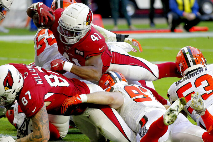Arizona Cardinals running back Kenyan Drake (41) dives into the end zone for the touchdown against the Cleveland Browns during the first half of an NFL football game, Sunday, Dec. 15, 2019, in Glendale, Ariz. (AP Photo/Ross D. Franklin)