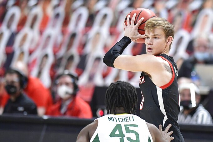 Texas Tech's Mac McClung (0) controls the ball during the first half of an NCAA college basketball game against Baylor in Lubbock, Texas, Saturday, Jan. 16, 2021. (AP Photo/Justin Rex)