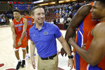 FILE  - In this Nov. 24, 2019, file photo, Florida's head coach Mike White celebrates after defeating Xavier 70-65 in an NCAA college basketball game during the finals of the Charleston Classic in Charleston, S.C. The Gators didn't have much fun last year. White is eager for his Gators to run and press like never before. Florida is scheduled to open their season Nov. 25, 2020, in Connecticut. (AP Photo/Mic Smith, File)