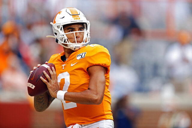 FILE - In this Oct. 26, 2019, file photo, Tennessee quarterback Jarrett Guarantano looks for a receiver during an NCAA college football game against South Carolina in Knoxville, Tenn. Guarantano and the 16th-ranked Tennessee Volunteers are about to find out how much having the same offensive coordinator for consecutive seasons can help a quarterback. (AP Photo/Wade Payne, File)