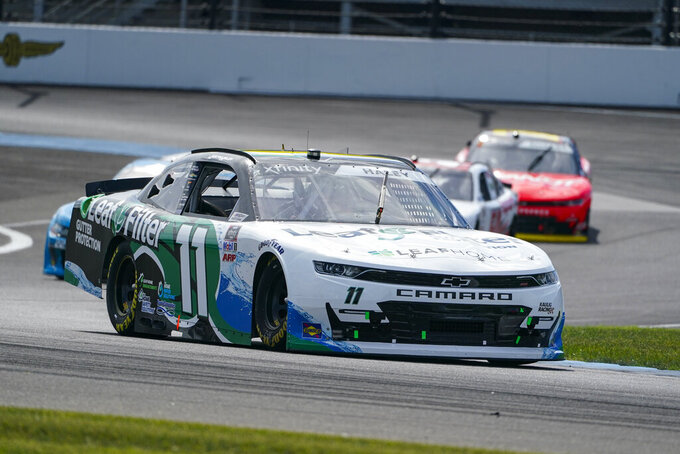 Justin Haley (11) drives through the second turn during the NASCAR Xfinity Series auto race at Indianapolis Motor Speedway in Indianapolis, Saturday, Aug. 14, 2021. (AP Photo/Michael Conroy)