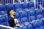 FILE - In this Sept. 10, 2019, file photo, a spectator naps during the playing of the National Anthem before the start of a baseball game between the Miami Marlins and the Milwaukee Brewers, in Miami. The Dolphins look like the worst team in the NFL, and might even be the worst team in Miami. On the other hand, a comparison with the Marlins is one matchup the Dolphins might win. (AP Photo/Wilfredo Lee, File)