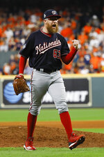 Washington Nationals relief pitcher Sean Doolittle celebrates after their win against the Houston Astros in Game 1 of the baseball World Series Tuesday, Oct. 22, 2019, in Houston. The Nationals won 5-4 to take a 1-0 lead in the series. (AP Photo/Matt Slocum)