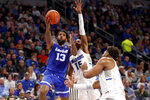 Seton Hall's Myles Powell (13) heads to the basket as Saint Louis' Demarius Jacobs (15) and Hasahn French defend during the first half of an NCAA college basketball game Sunday, Nov. 17, 2019, in St. Louis. (AP Photo/Jeff Roberson)