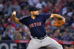 Boston Red Sox starting pitcher Nathan Eovaldi throws to the plate during the first inning of a baseball game against the Los Angeles Angels, Friday, Aug. 30, 2019, in Anaheim, Calif. (AP Photo/Mark J. Terrill)