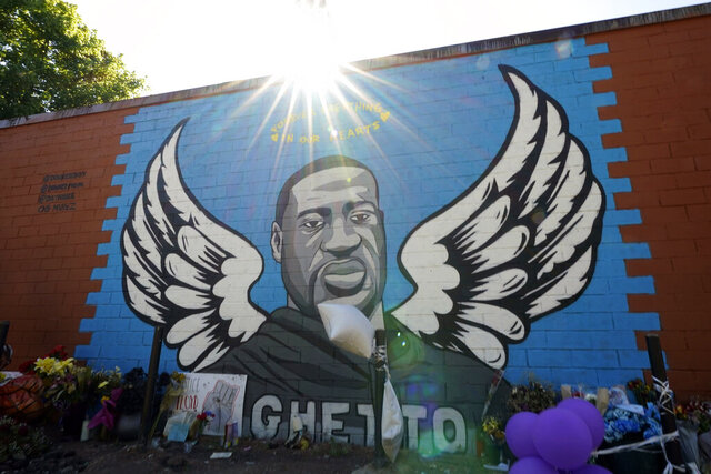 In this Sunday, June 7, 2020, photo, the sun shines above a mural honoring George Floyd in Houston's Third Ward. Floyd, who grew up in the Third Ward, died after being restrained by Minneapolis police officers on Memorial Day. (AP Photo/David J. Phillip)