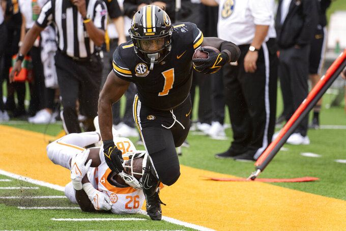 Missouri running back Tyler Badie, right, is tackled by Tennessee defensive back Theo Jackson during the first half of an NCAA college football game Saturday, Oct. 2, 2021, in Columbia, Mo. (AP Photo/L.G. Patterson)