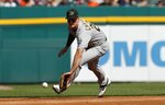 Oakland Athletics third baseman Matt Chapman fields a ground ball for an out hit by Detroit Tigers' Grayson Greiner during the second inning of a baseball game, Saturday, May 18, 2019, in Detroit. (AP Photo/Carlos Osorio)