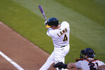 Oakland Athletics' Jake Lamb hits an RBI-single off San Francisco Giants starting pitcher Logan Webb in the first inning of a baseball game Friday, Sept. 18, 2020, in Oakland, Calif. (AP Photo/Eric Risberg)