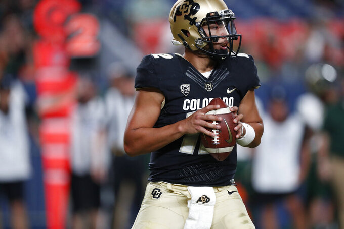 Colorado quarterback Steven Montez looks to pass the ball against Colorado State in the fourth quarter of an NCAA college football game Friday, Aug. 30, 2019, in Denver. Colorado won 52-31. (AP Photo/David Zalubowski)