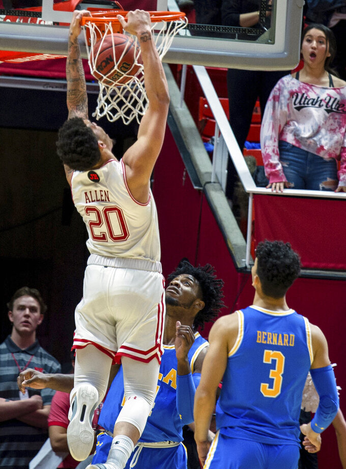 Utah forward Timmy Allen (20) dunks in the first half of an NCAA college basketball game against UCLA, Saturday, March 9, 2019, in Salt Lake City. (AP Photo/Tyler Tate)