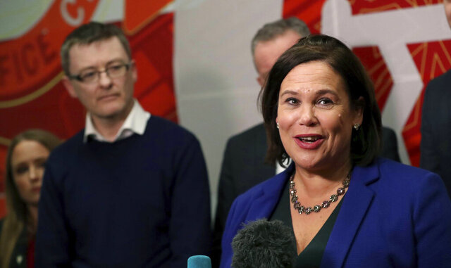 Sinn Féin's President Mary Lou McDonald addresses the media in Dublin, as Sinn Féin's David Cullinane looks on, in Dublin, Ireland, Monday, Feb. 10, 2020. Ireland braced for weeks of political uncertainty Monday after an earth-shaking election that saw the Irish Republican Army-linked party Sinn Fein — long shunned by its bigger rivals — take the largest share of votes. (Niall Carson/PA via AP)